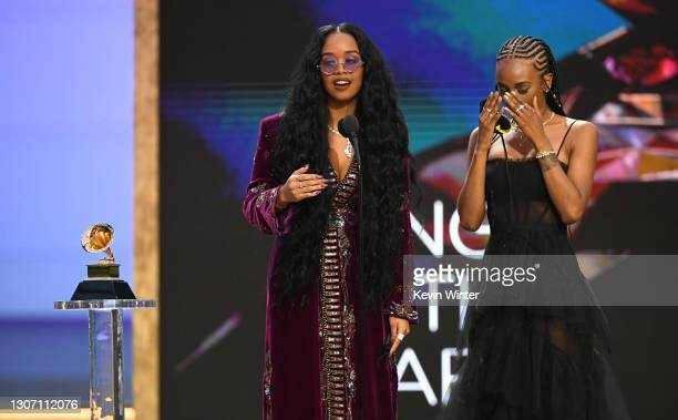 And Tiara Thomas accept the Song of the Year award for 'I Can't Breathe' onstage during the 63rd Annual GRAMMY Awards at Los Angeles Convention...