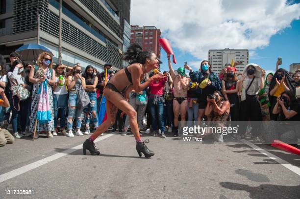 And transgender demonstrators dance in form of protest in Bogota, Colombia on May 9 2021, as peaceful demonstrarions against police brutality had...