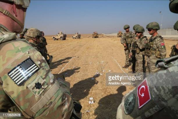 US and Turkish troops conduct their third joint ground patrol within a planned safe zone in northern Syria along the SyrianTurkish border in Tell...