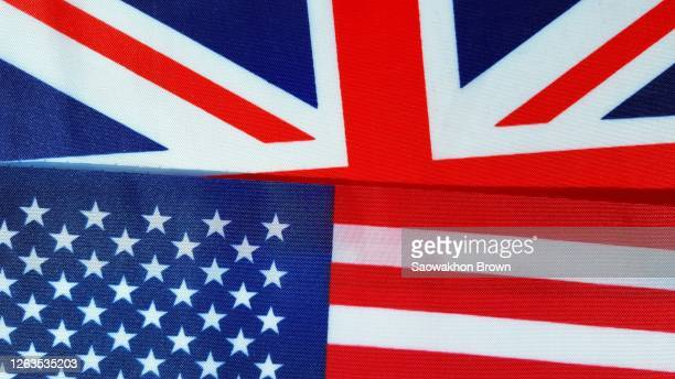 usa and uk flag together background - stars and stripes stock pictures, royalty-free photos & images