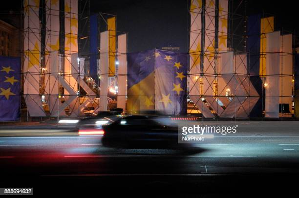 EU and Ukrainian flags are seen on display on Khreshchatyk street one of the main roads in the center of Kiev Ukraine on December 9 2017