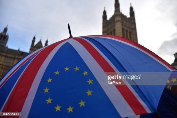 EU and Union flags are waved outside the Parliament to protest against Brexit on November 27 2018 in London England Theresa May will visit Wales and...