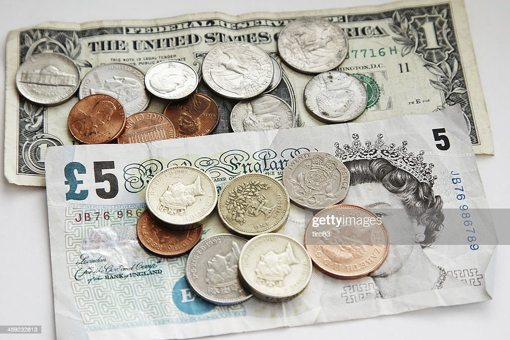 Uk And Usa Currency Fiver With Change Stock Photo