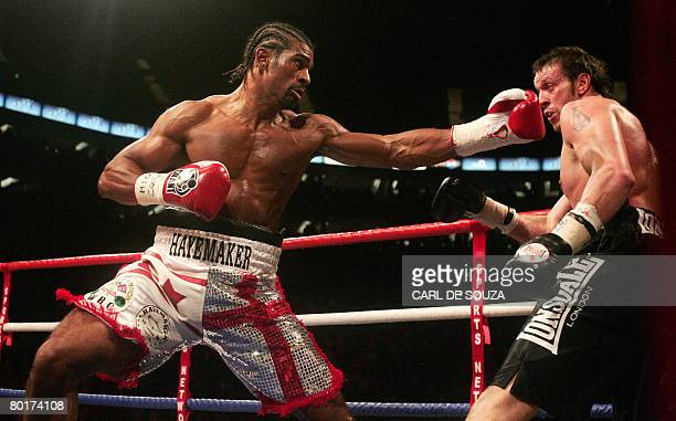 And WBA Cruiserweight World Champion David Haye begins a series of combination punches to knock down Welsh WBO Cruiserweight World Champion Enzo...