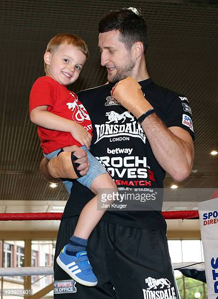 IBF and WBA supermiddleweight champion Carl Froch poses with son Rocco ahead of his work out at Broadmarsh Shopping Centre on May 26 2014 in...
