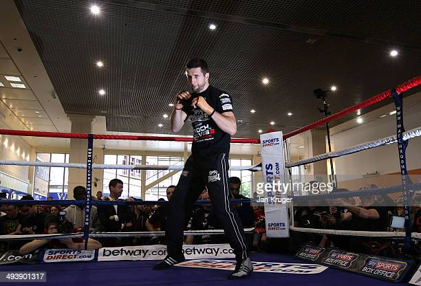 And WBA super-middleweight champion Carl Froch works out at Broadmarsh Shopping Centre on May 26, 2014 in Nottingham, England.