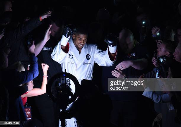And WBA world heavyweight champion Anthony Joshua of Great Britain enters the ring for his unification bout against New Zealand's WBO champion Joseph...