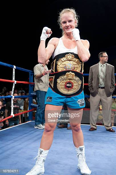 IBA and WBAN Jr Welterweight Champion Holly Holm poses wearing her two latest belts after defeating Ann Marie Saccurato with a TKO in the 8th at...