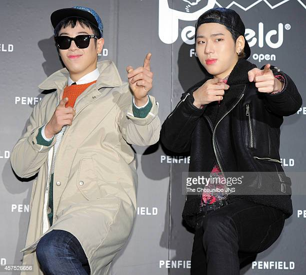 O and Zico of Block B pose for photographs during the Penfield popup store opening event at Sinsadong on October 15 2014 in Seoul South Korea