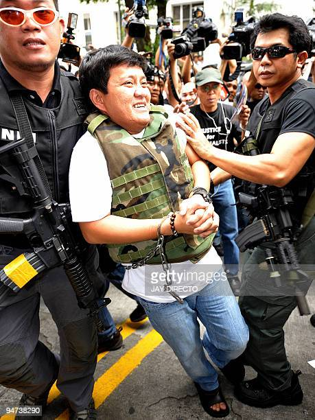 Andal Ampatuan Jnr in chain member of a powerful clan in the southern Philippines arrives at the Philippine Department of Justice in Manila on...