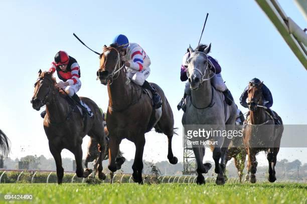Andaz ridden by Ben Melham dead heats with Royal Phoenix ridden by James Winks in Eugene Gorman Handicap at Flemington Racecourse on June 09 2017 in...