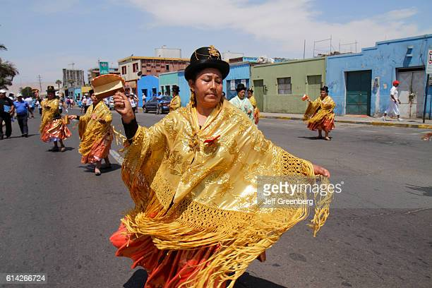 Andean Carnival parade rehearsal woman in a chola dress