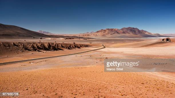 andean plain, pacana caldera, ruta 27 road to the paso jama border to argentina, san pedro de atacama, el loa, antofagasta, norte grande, chile - caldera stock pictures, royalty-free photos & images