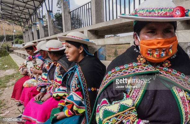 Andean women gather to receive cloth material on June 12 2020 in Ayata Bolivia Andean women sew and embroider face masks with traditional Andean...