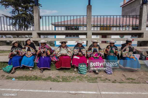 Andean women make protective masks with traditional themes on June 12 2020 in Ayata Bolivia Andean women sew and embroider face masks with...