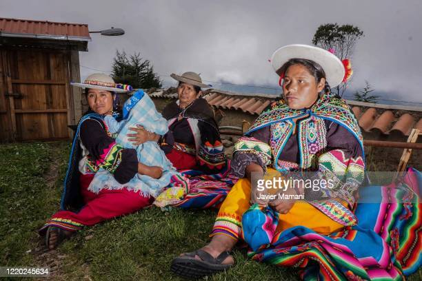 Andean women prepare to embroider protective masks on June 12 2020 in Ayata Bolivia Andean women sew and embroider face masks with traditional Andean...