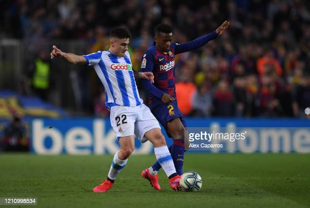 Ander Barrenetxea of Real Sociedad battles for possession with Nelson Semedo of FC Barcelona during the La Liga match between FC Barcelona and Real...
