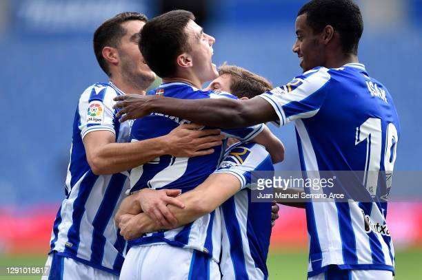 Ander Barrenetxea of Real Sociedad celebrates with teammates after scoring their team's first goal during the La Liga Santander match between Real...