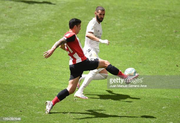 Ander Capa of Athletic Bilbao battles for possession with Karim Benzema of Real Madrid during the La Liga match between Athletic Club and Real Madrid...
