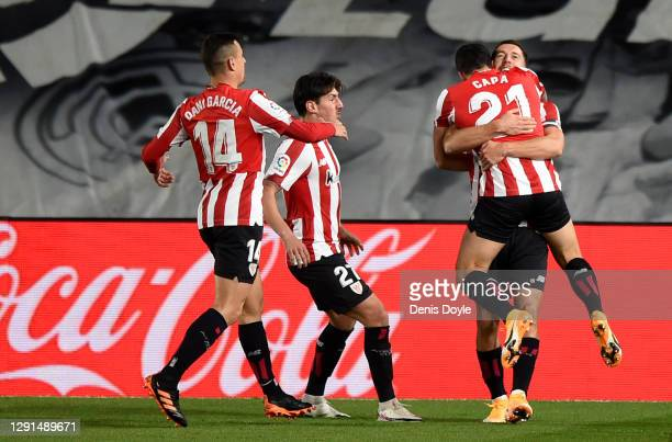 Ander Capa of Athletic Bilbao celebrates with his teammates after scoring his sides first goal during the La Liga Santander match between Real Madrid...