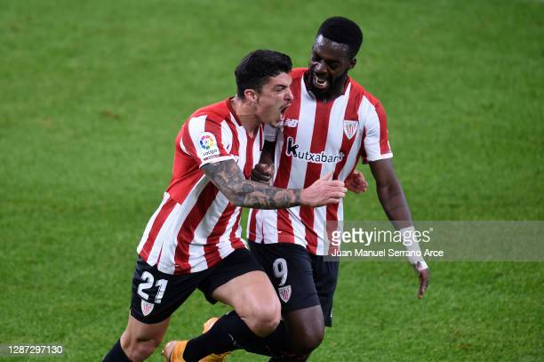 Ander Capa of Athletic Bilbao celebrates with Inaki Williams after scoring their team's second goal during the La Liga Santander match between...