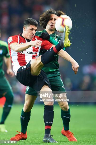 Ander Capa of Athletic Club competes for the ball with Marc Cucurella of SD Eibar during the La Liga match between Athletic Club and SD Eibar at San...