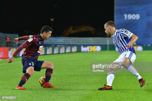 Ander Capa of Eibar duels for the ball with Kevin Rodrigues of Real Sociedad during the Spanish league football match between Real Sociedad and Eibar...