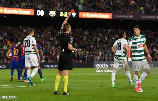 Ander Capa of Eibar is shown a red card by referee AAlejandro Jose Hernandez Hernandez during the La Liga match between Barcelona and Eibar at Camp...