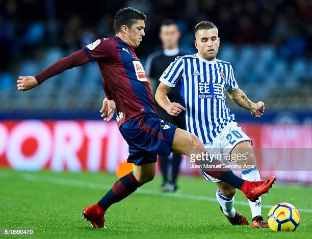 Ander Capa of SD Eibar competes for the ball with Kevin Rodrigues of Real Sociedad during the La Liga match between Real Sociedad and Eibar at...