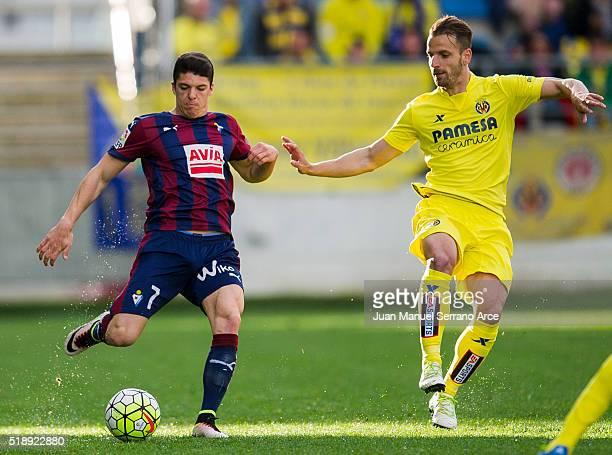 Ander Capa of SD Eibar duels for the ball with Roberto Soldado of Villarreal CF during the La Liga match between SD Eibar and Villarreal CF at Ipurua...