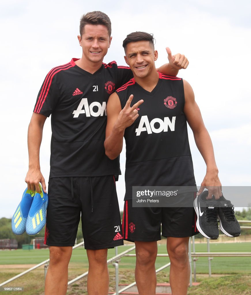 Ander Herrera and Alexis Sanchez of Manchester United walk out ahead of a first team training session at Aon Training Complex on July 11, 2018 in Manchester, England.