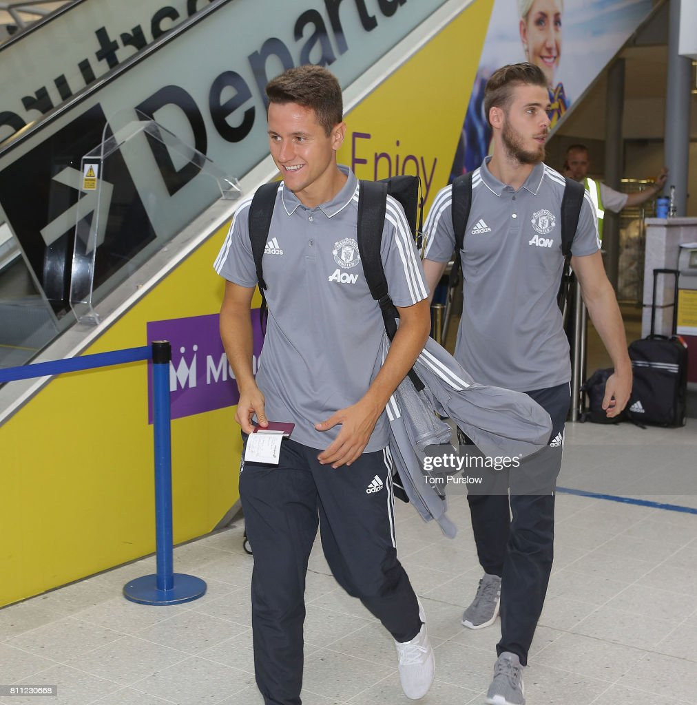 Ander Herrera and David de Gea of Manchester United checks in at Manchester Airport ahead of the club's pre-season tour of the USA at Manchester Airport on July 9, 2017 in Manchester, England.