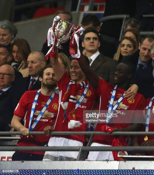 Ander Herrera and Eric Bailly of Manchester United lift the EFL Cup after the EFL Cup Final match between Manchester United and Southampton at...