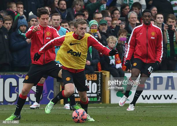 Ander Herrera and James Wilson of Manchester United warm up ahead of the FA Cup Third Round match between Yeovil Town and Manchester United at Huish...