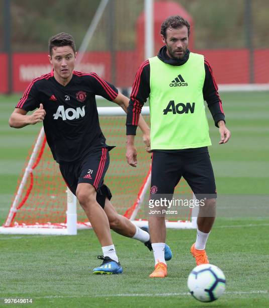 Ander Herrera and Juan Mata of Manchester United in action during a first team training session at Aon Training Complex on July 13 2018 in Manchester...