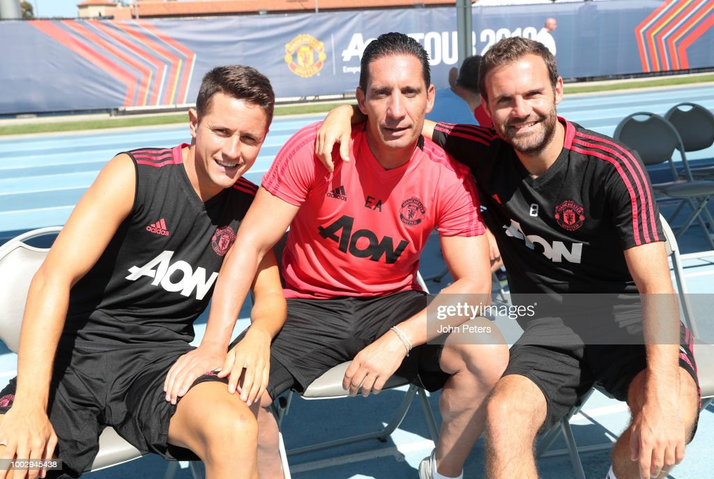 Ander Herrera (L) and Juan Mata (R) of Manchester United pose with Goalkeeping Coach Emilio Alvarez Blanco during a Manchester United pre-season training session at UCLA on July 20, 2018 in Los Angeles, California.