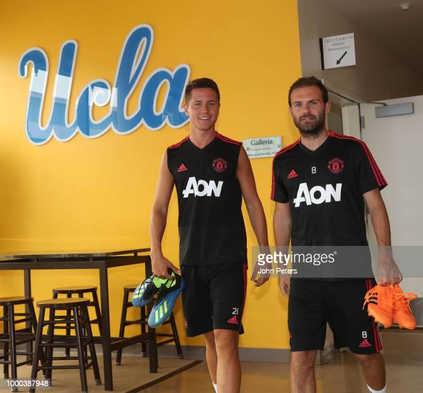 Ander Herrera and Juan Mata of Manchester United walk out of the dressing room during a Manchester United preseason training session at UCLA on July...
