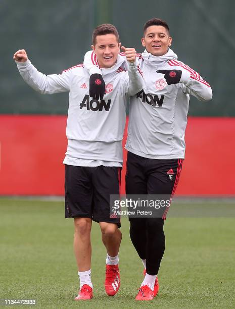 Ander Herrera and Marcos Rojo of Manchester United in action during a training session at Aon Training Complex on March 08 2019 in Manchester England