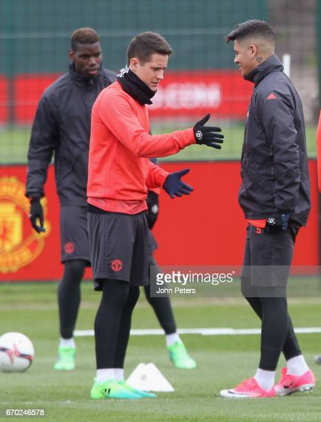 Ander Herrera and Marcos Rojo of Manchester United in action during a first team training session at Aon Training Complex on April 19 2017 in...