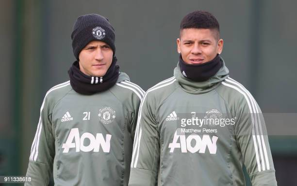 Ander Herrera and Marcos Rojo of Manchester United in action during a first team training session at Aon Training Complex on January 28 2018 in...