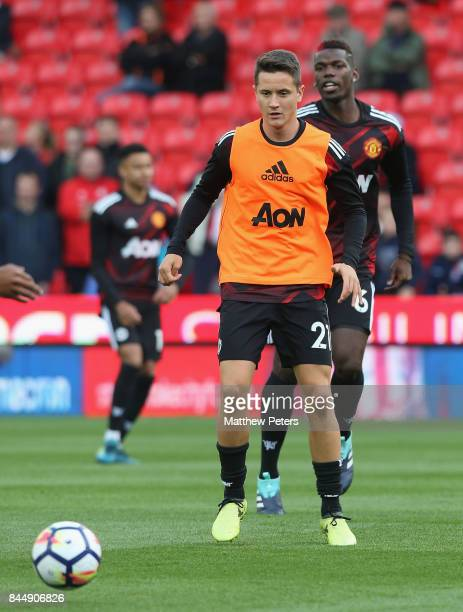 Ander Herrera and Paul Pogba of Manchester United warm up ahead of the Premier League match between Stoke City and Manchester United at Bet365...