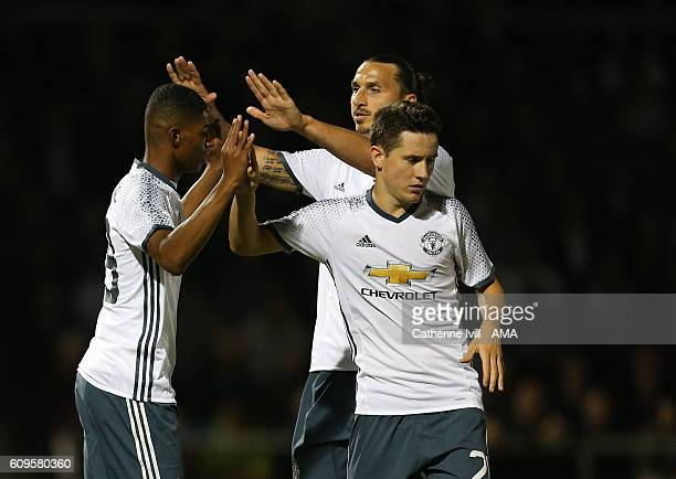 Ander Herrera and Zlatan Ibrahimovic of Manchester United congratulate Marcus Rashford of Manchester United after he scores during the EFL Cup match...
