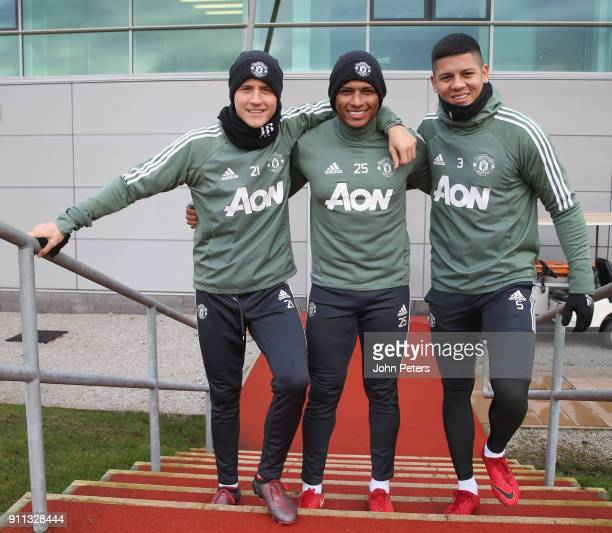 Ander Herrera Antonio Valencia and Marcos Rojo of Manchester United in action during a first team training session at Aon Training Complex on January...