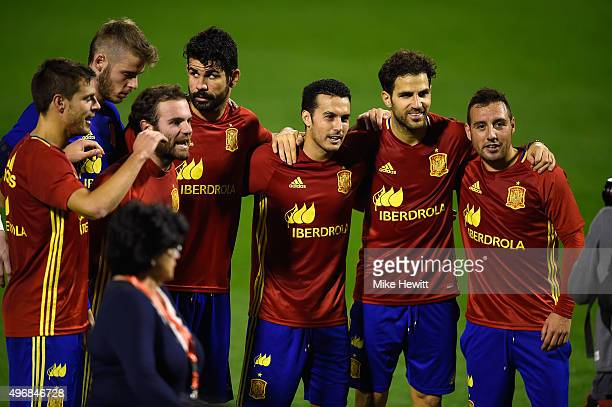 Ander Herrera David de Gea Juan Mata Diego Costa Pedro Cesc Fabregas and Santi Cazorla of Spain pose for a photo after an open Spain training session...