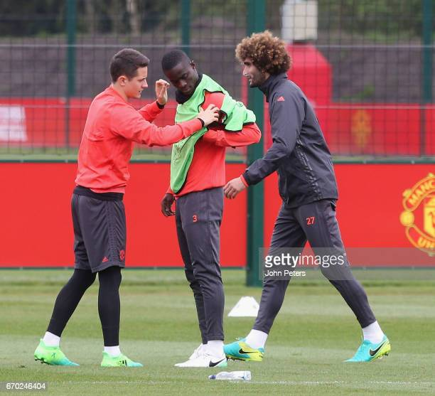 Ander Herrera Eric Bailly and Marouane Fellaini of Manchester United in action during a first team training session at Aon Training Complex on April...