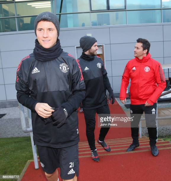 Ander Herrera Juan Mata and Assistant Manager Rui Faria of Manchester United walk out ahead of a first team training session at Aon Training Complex...