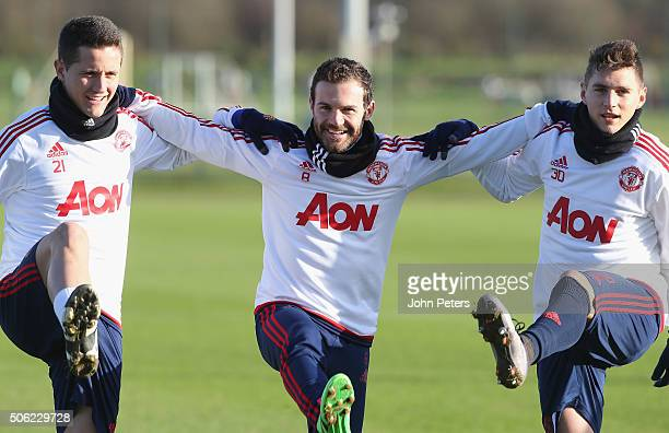 Ander Herrera Juan Mata and Guillermo Varela of Manchester United in action during a first team training session at Aon Training Complex on January...