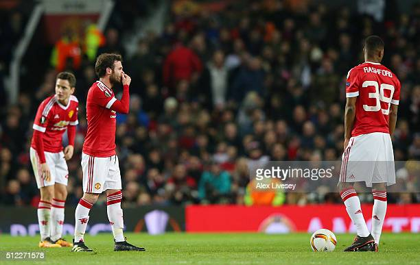 Ander Herrera Juan Mata and Marcus Rashford of Manchester United show their dejection after Midtjylland's first goal during the UEFA Europa League...