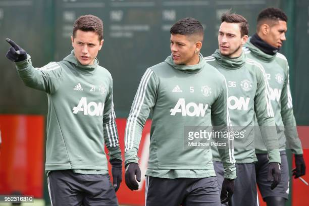 Ander Herrera Marcos Rojo and Matteo Darmian of Manchester United in action during a first team training session at Aon Training Complex on April 28...