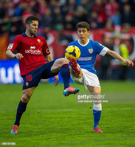 Ander Herrera of Athletic Club duels for the ball with Alvaro Cejudo of CA Osasuna during the La Liga match between CA Osasuna and Athletic Club...
